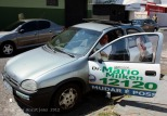 One of the many campaign cars with a large sound system on the roof.