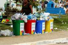 Overflowing garbage bins at the cemetery.